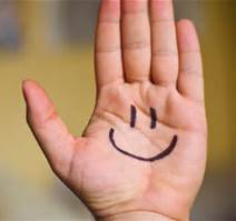Smile writen on hand